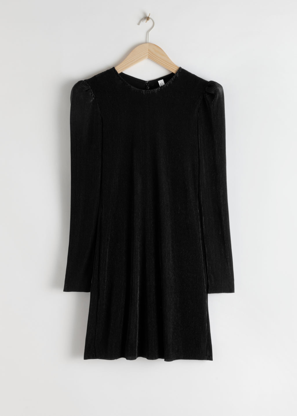 Front image of Stories plissé pleated mini dress in black