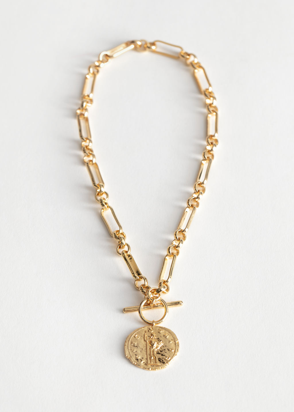 Front image of Stories coin pendant chain necklace in gold