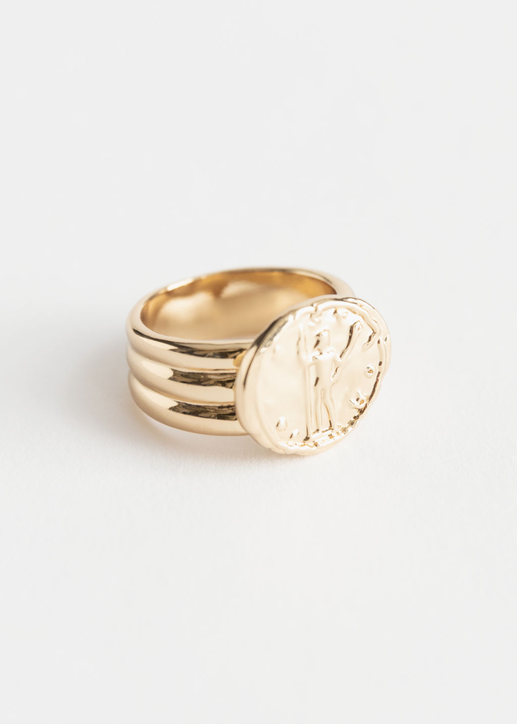Front image of Stories coin pendant signet ring in gold