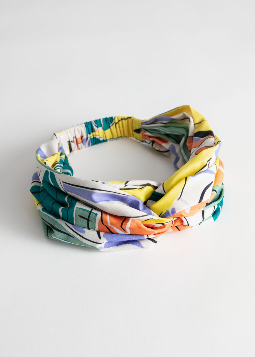 Front image of Stories tropical print knot hairband in white