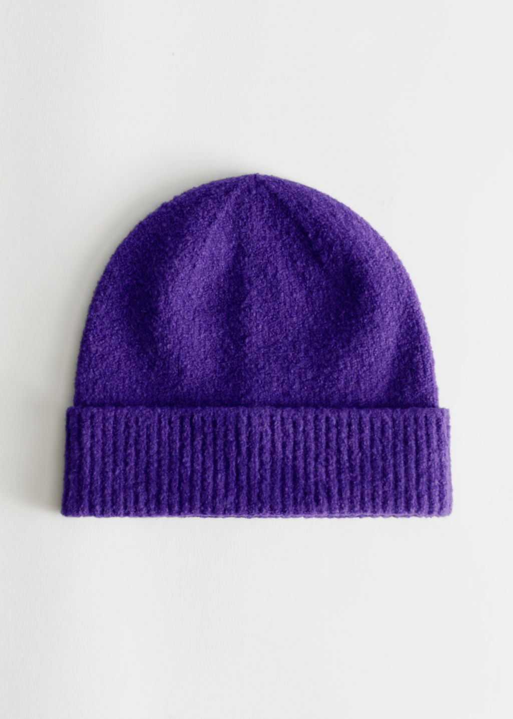 StillLife Front Image of Stories Soft Bouclé Beanie in Purple