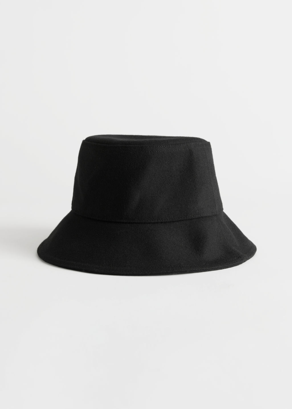 Front image of Stories felt wool blend bucket hat in black