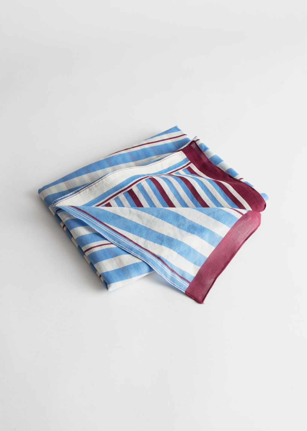 Front image of Stories striped cotton scarf in turquoise