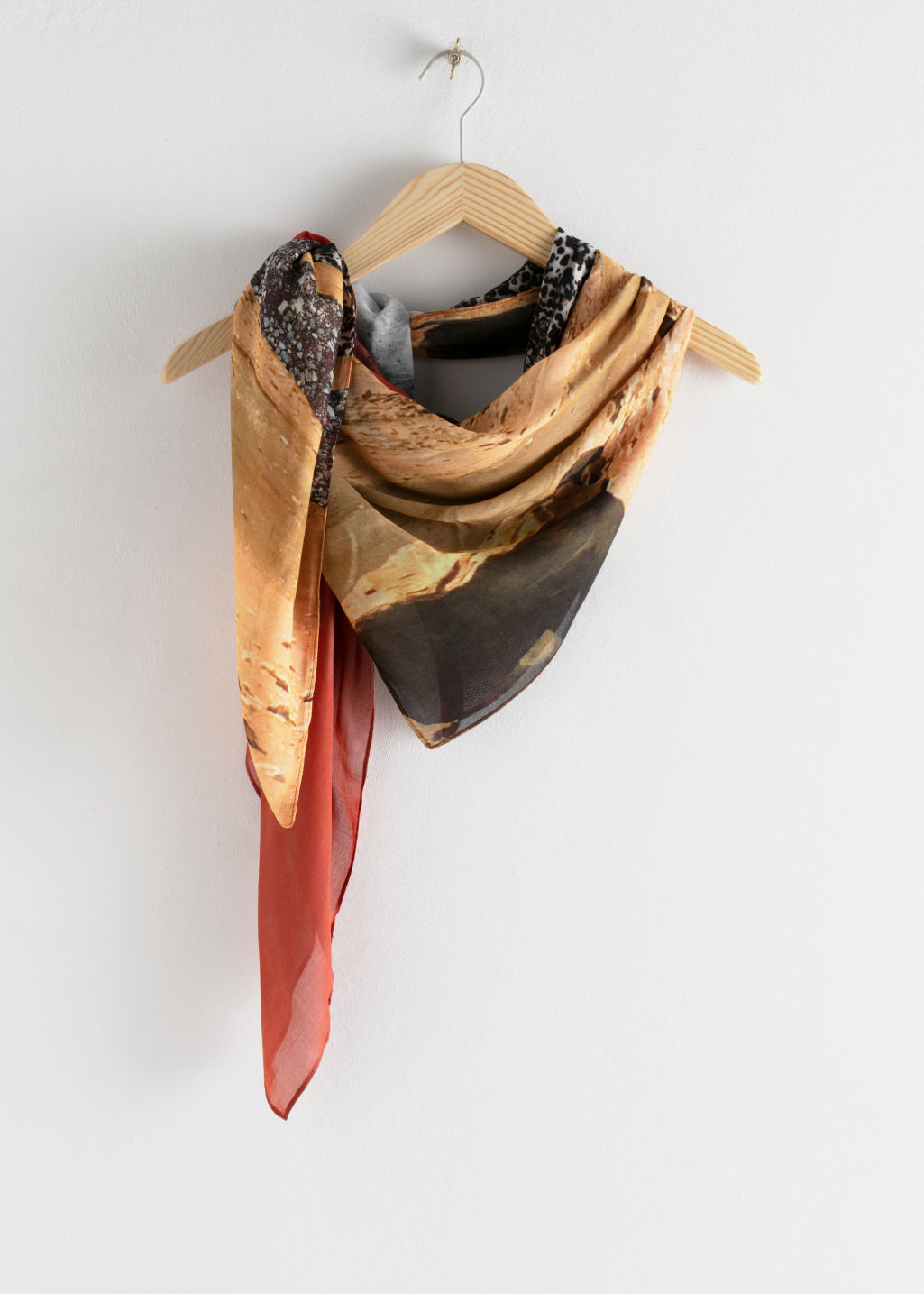 Front image of Stories desert graphic print scarf in orange