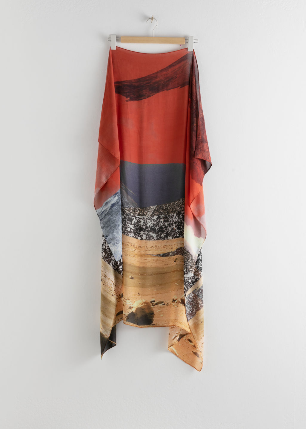 Back image of Stories desert graphic print scarf in orange