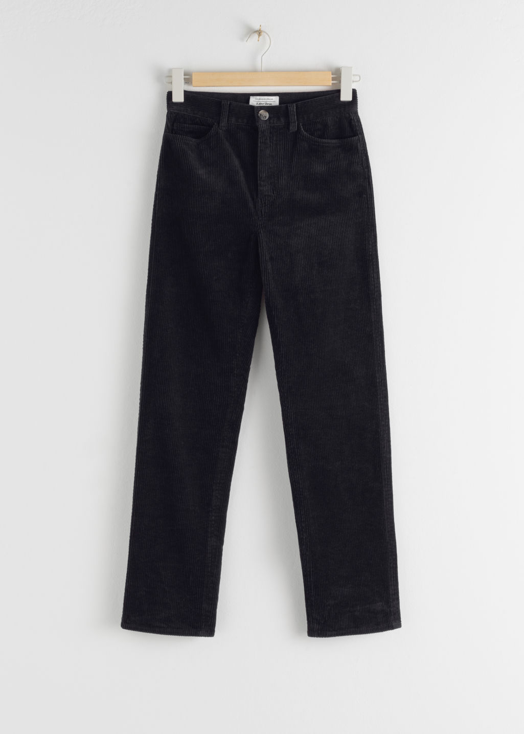 Front image of Stories high rise tapered corduroy trousers in blue