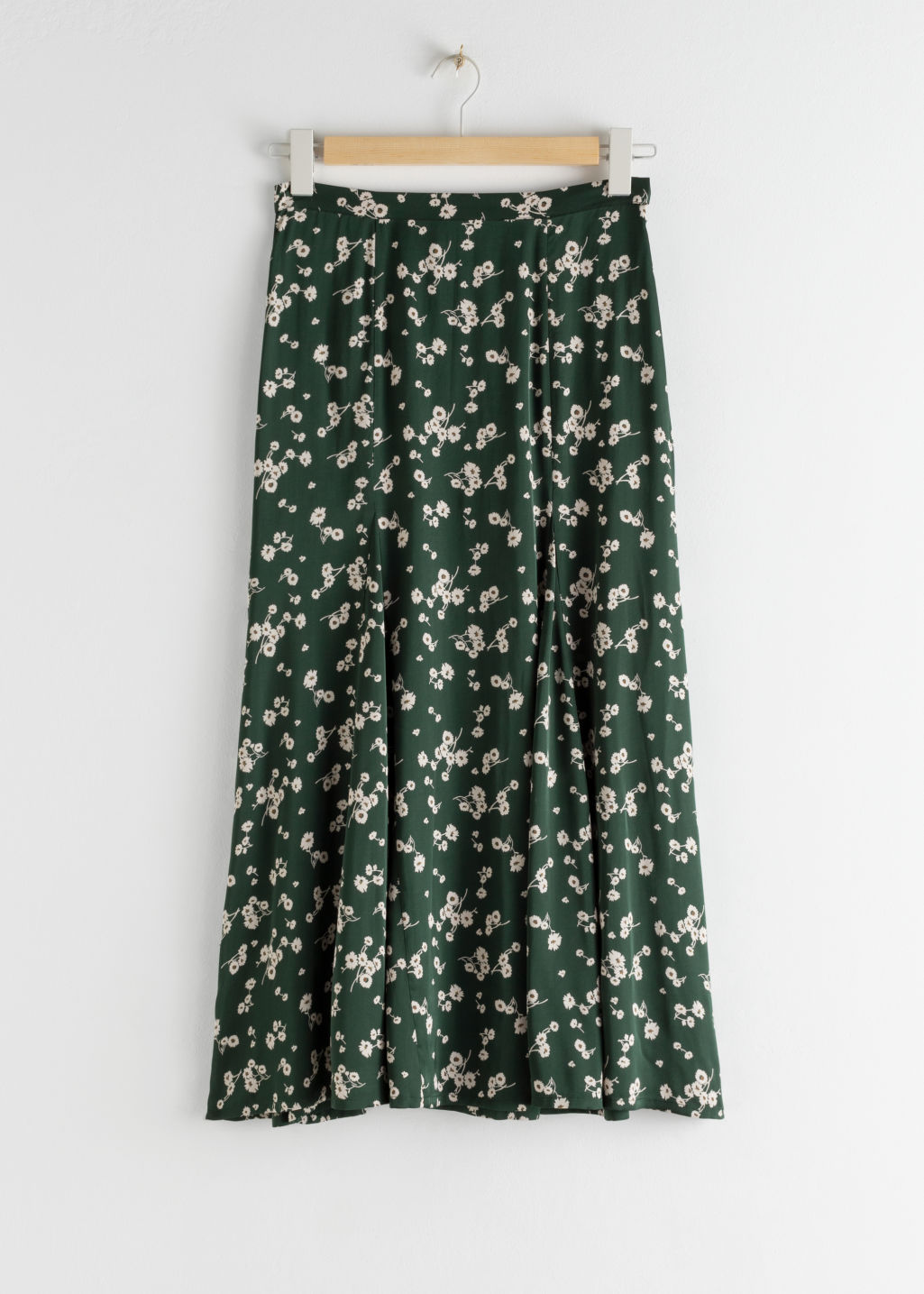 Front image of Stories daisy print flared midi skirt in green