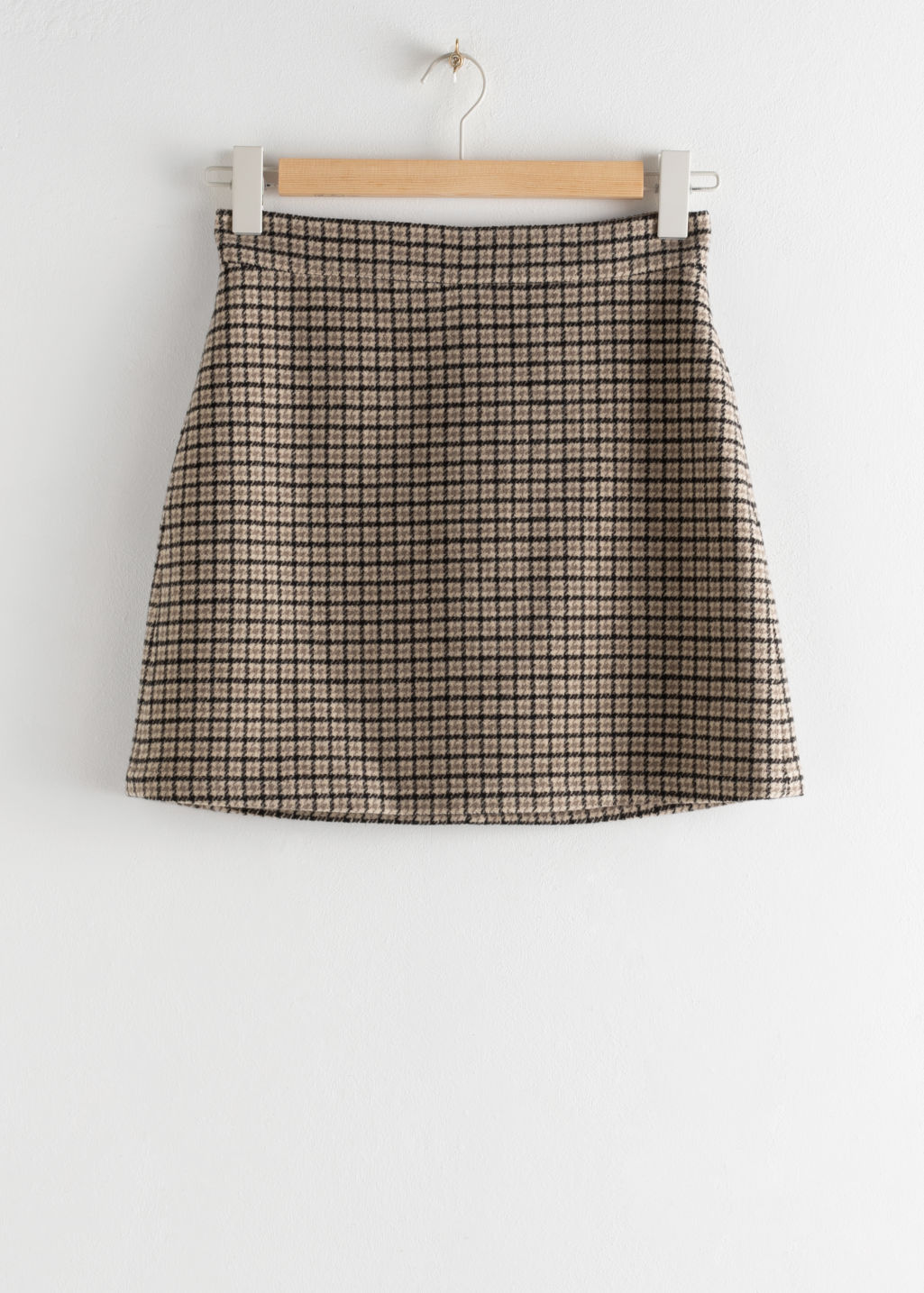 Front image of Stories houndstooth wool blend mini skirt in beige
