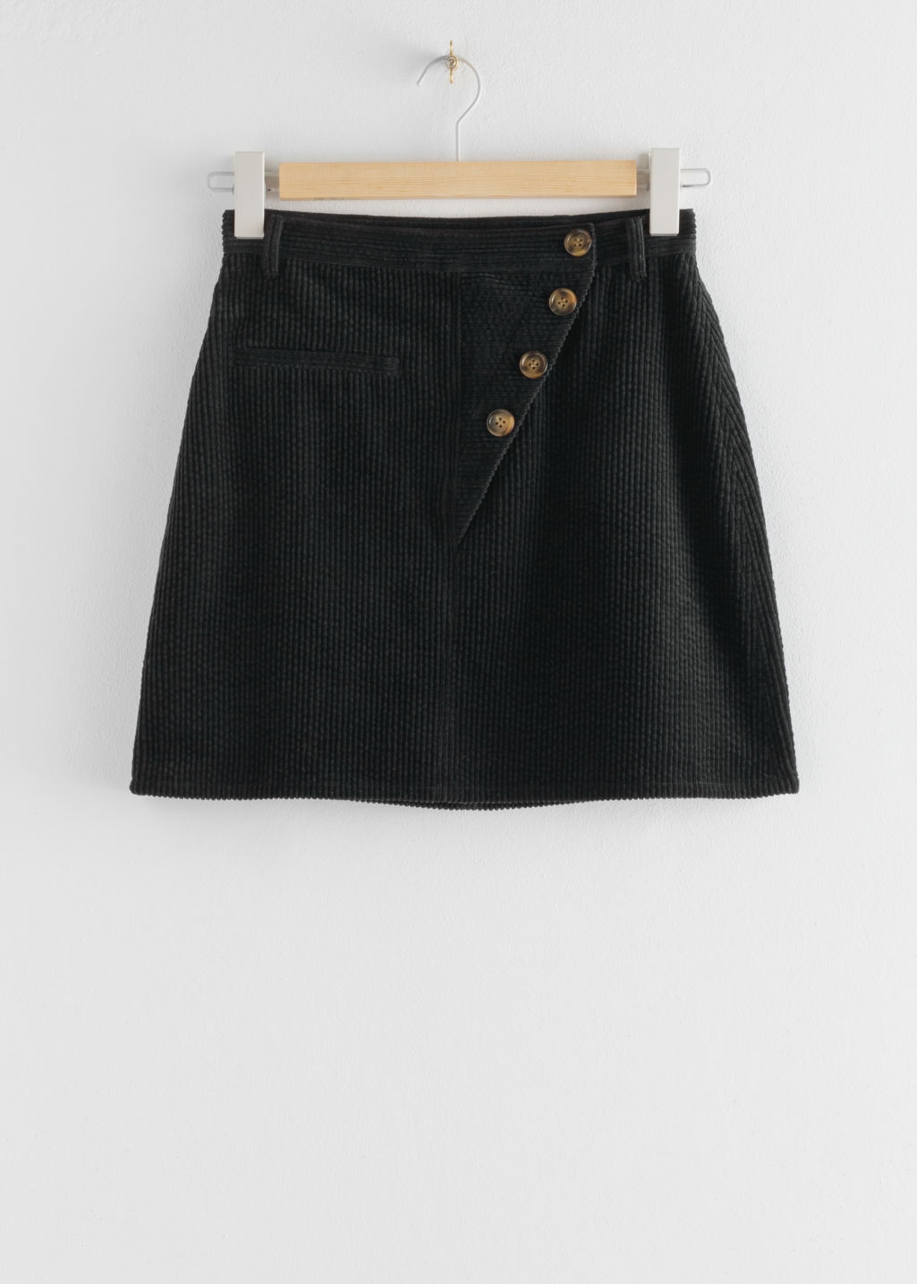 Front image of Stories corduroy button fly mini skirt in black