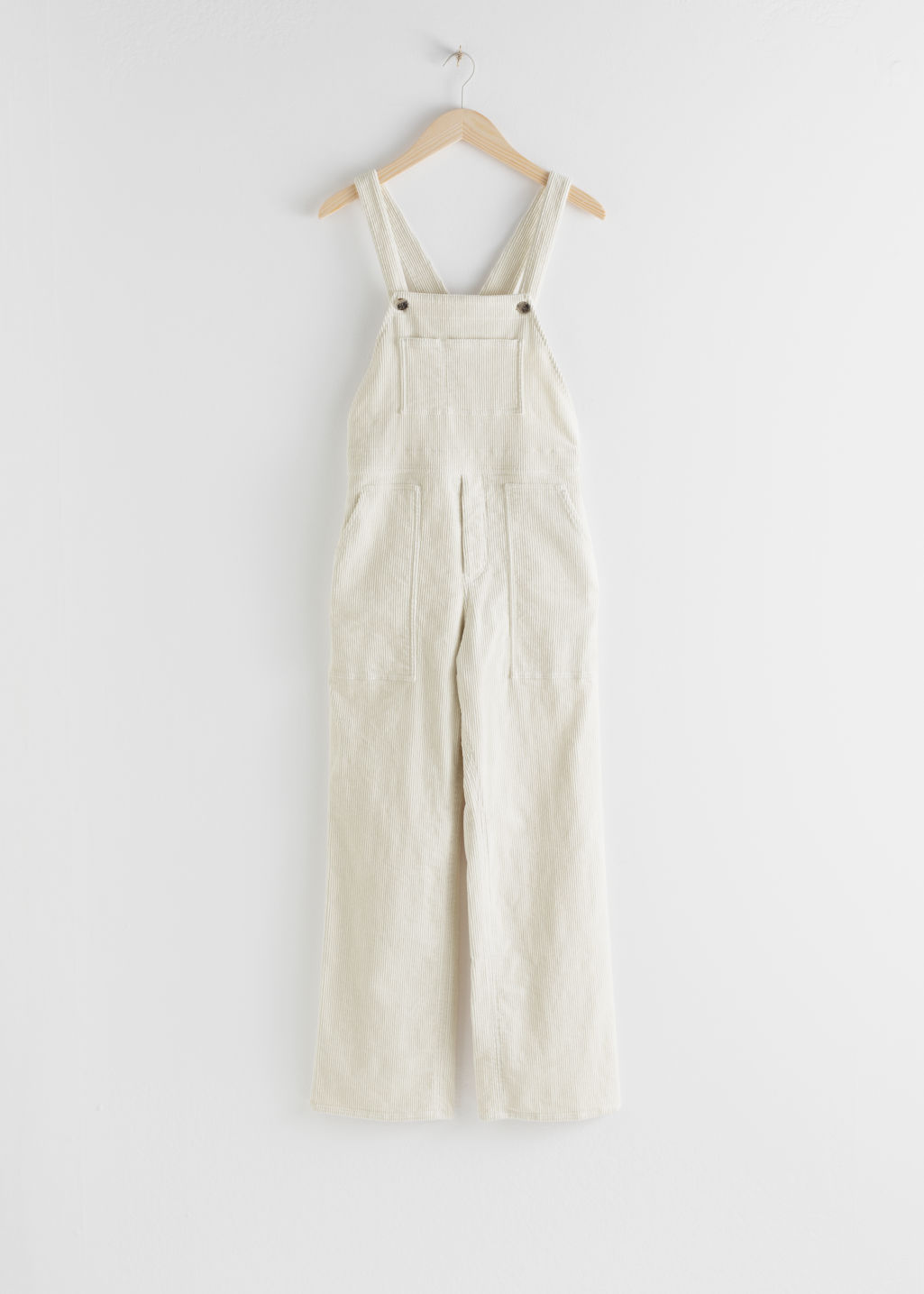 Front image of Stories corduroy utility overall dungarees in white