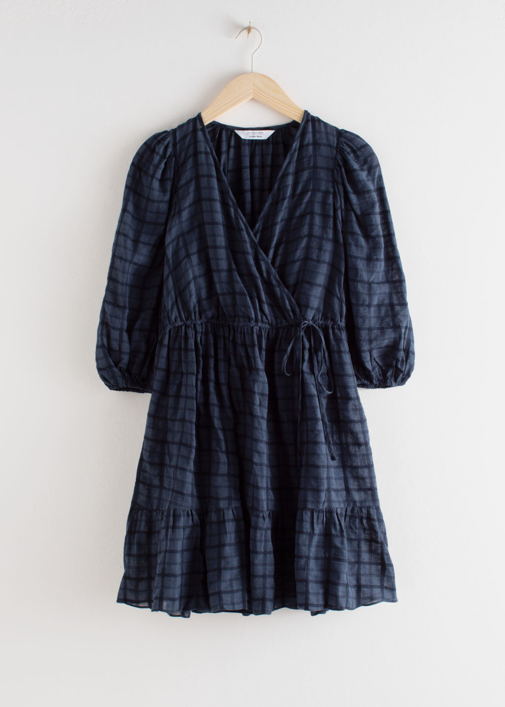 Front image of Stories gathered dobby cotton mini wrap dress in blue