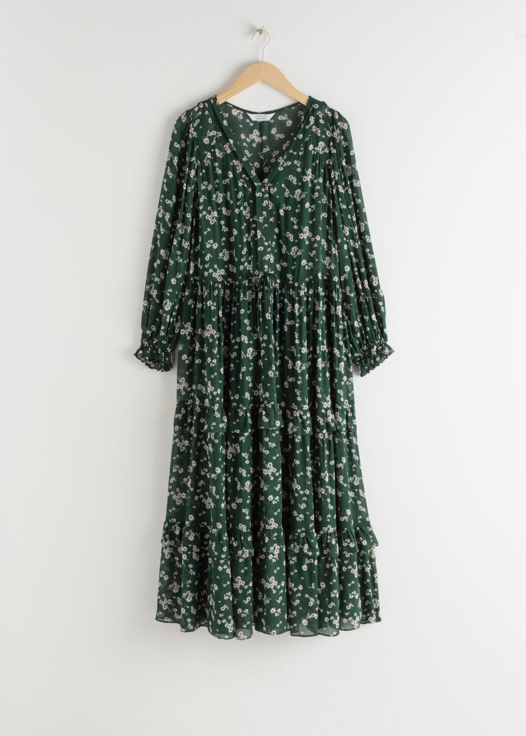 Front image of Stories floral v-neck ruffle midi dress in green