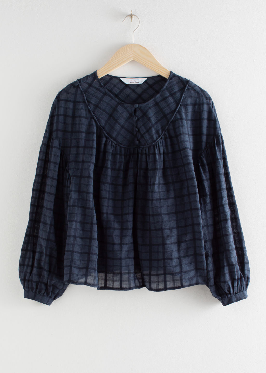 Front image of Stories gathered puff sleeve blouse in blue