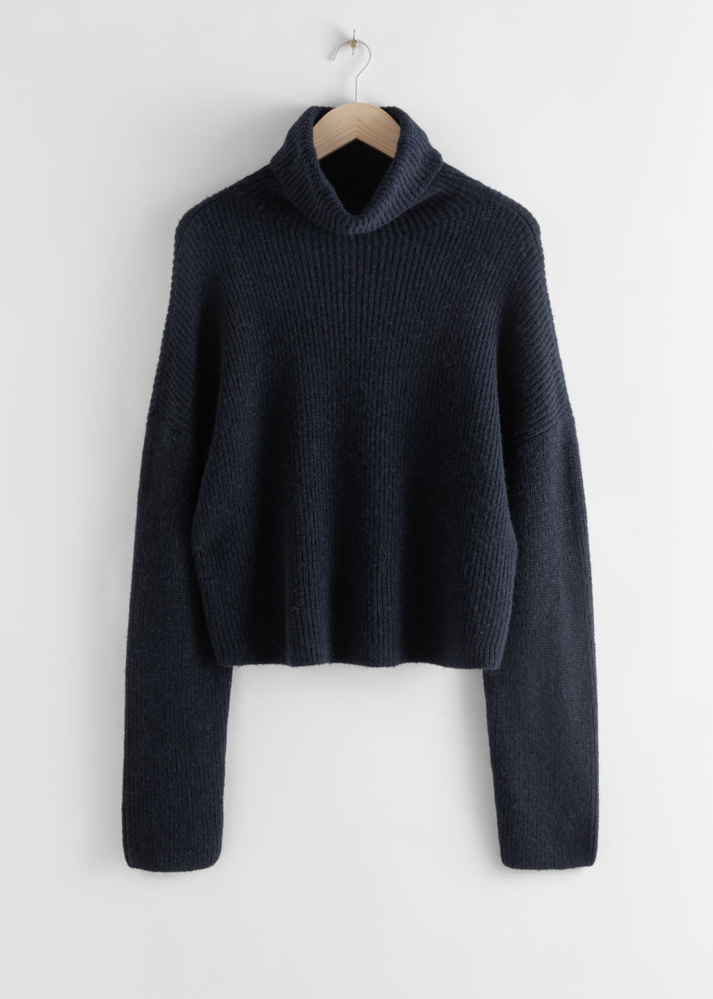 Front image of Stories slouchy ribbed knit turtleneck in blue