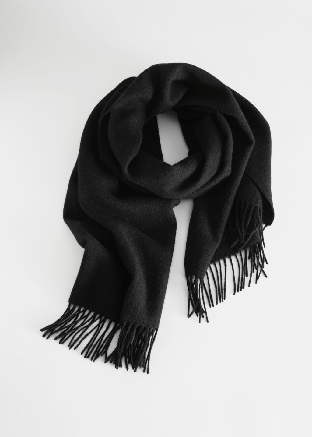 Front image of Stories wool fringed blanket scarf in black