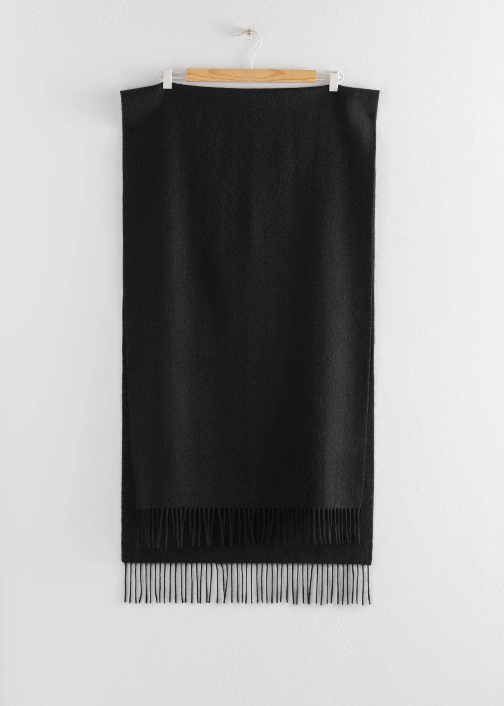 Back image of Stories wool fringed blanket scarf in black