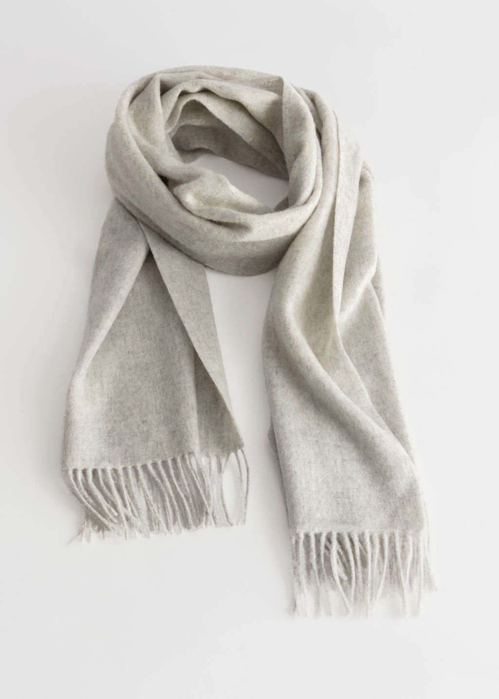 Front image of Stories wool fringed blanket scarf in white