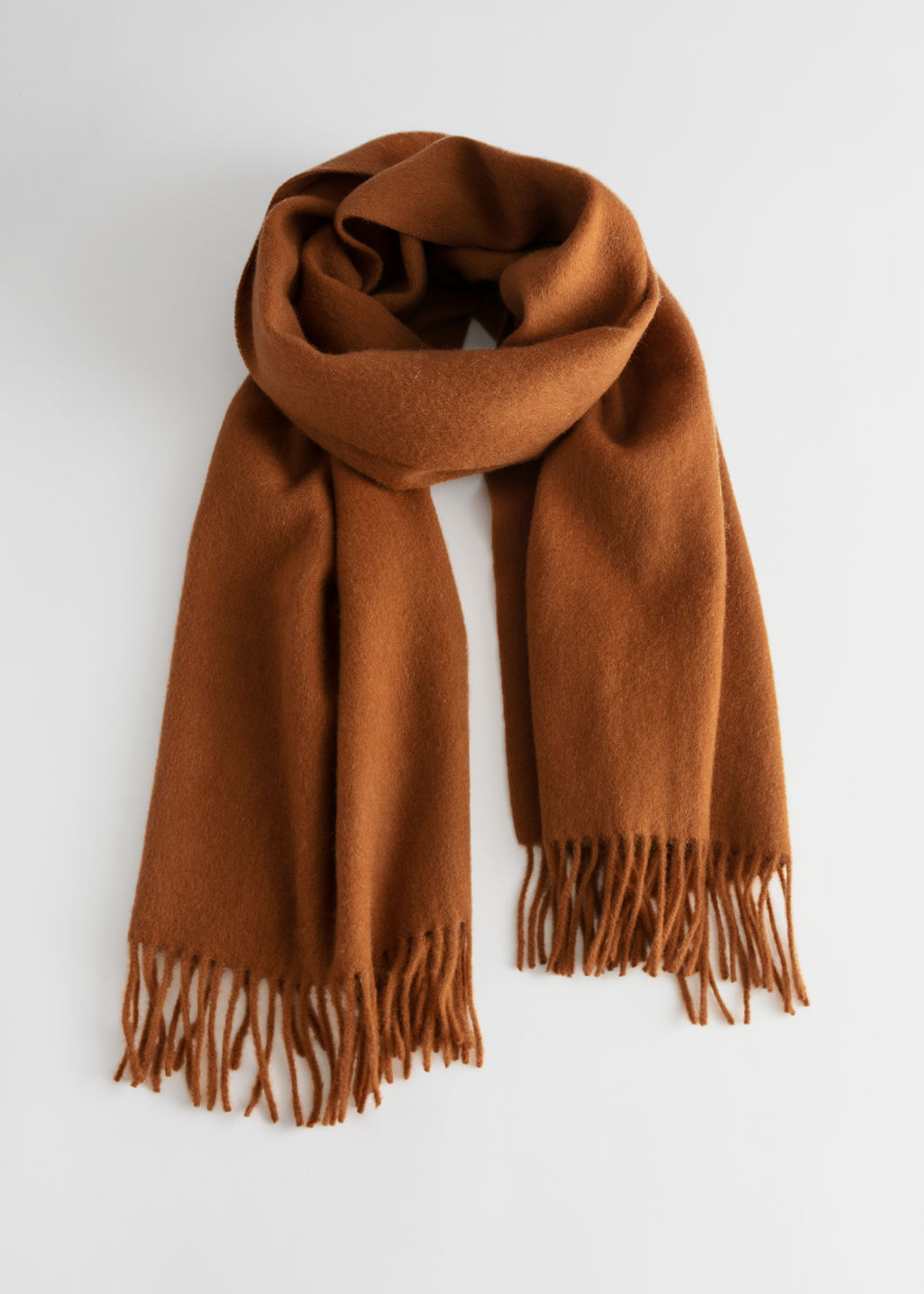 Front image of Stories wool fringed blanket scarf in beige