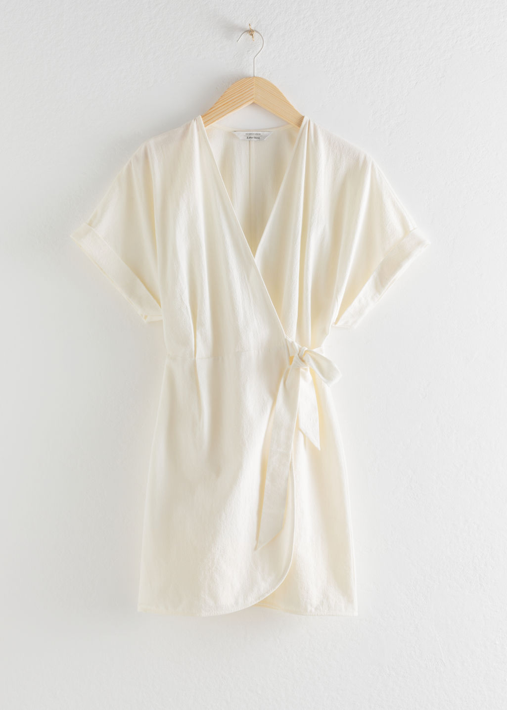 Front image of Stories organic cotton wrap mini dress in white