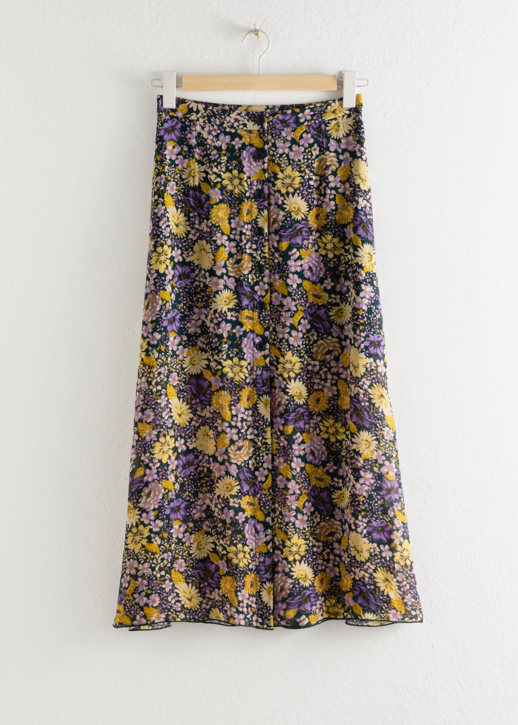 Front image of Stories floral button up midi skirt in green