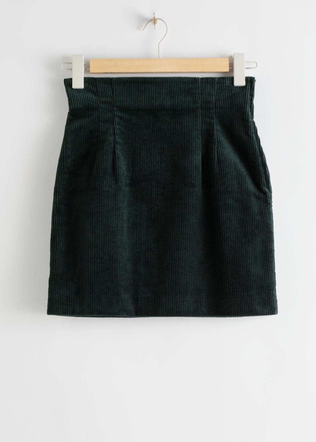 Front image of Stories corduroy zip up mini skirt in green