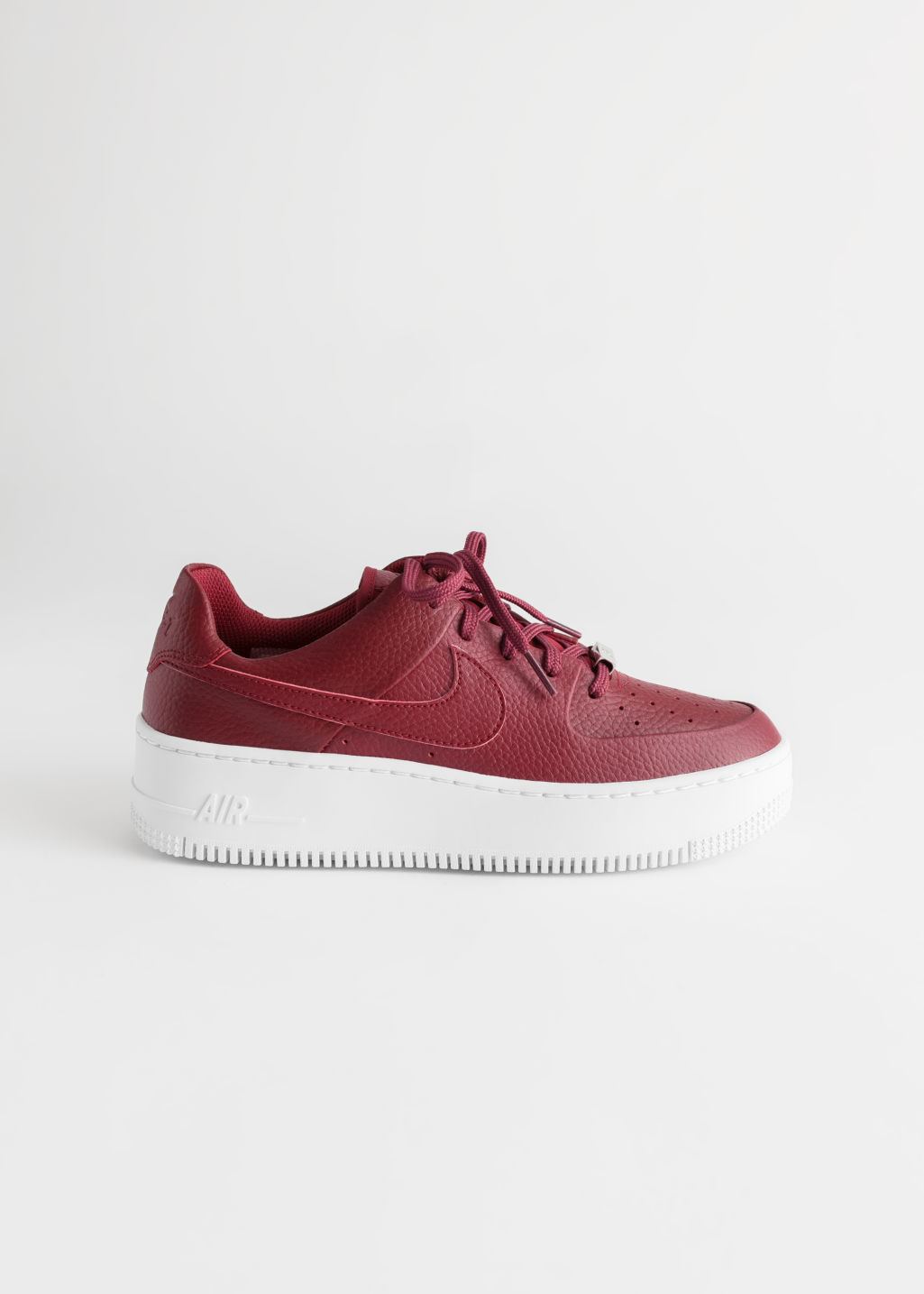 Front image of Stories nike air force 1 sage low sneakers in red
