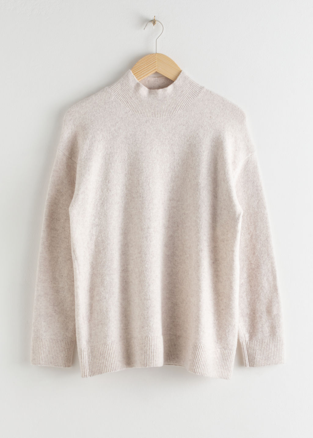Front image of Stories relaxed turtleneck sweater in beige