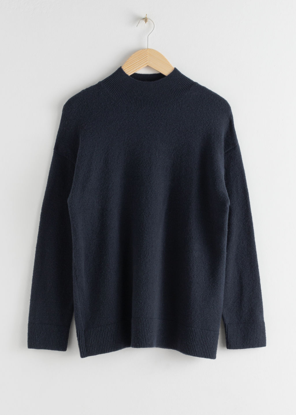 Front image of Stories relaxed turtleneck sweater in blue