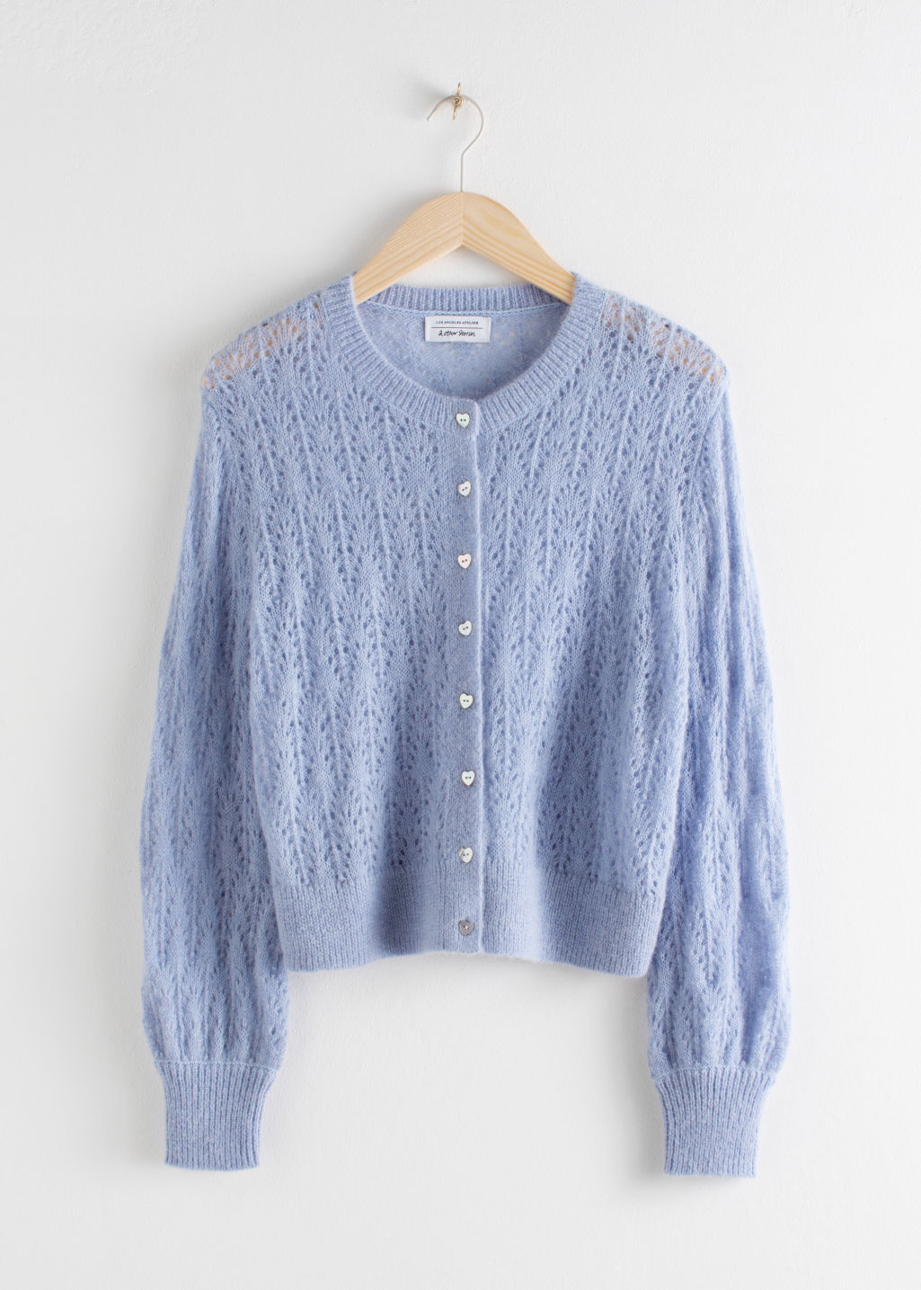 Front image of Stories puff sleeved eyelet knit cardigan in purple