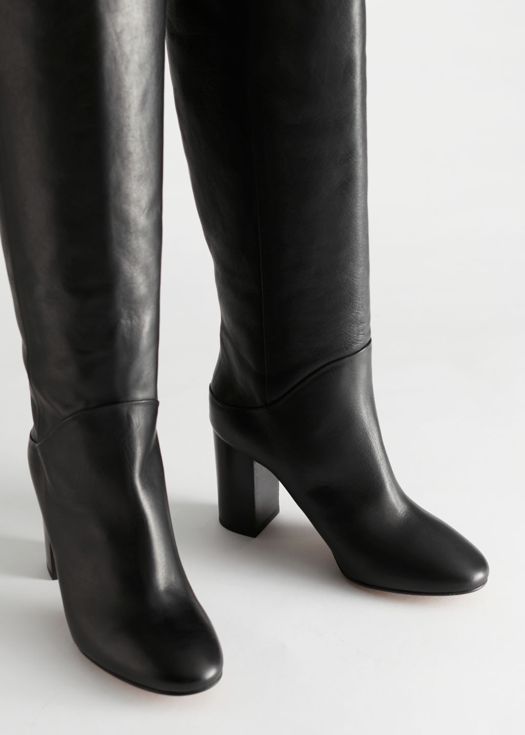 Front image of Stories soft leather block heel boots in black