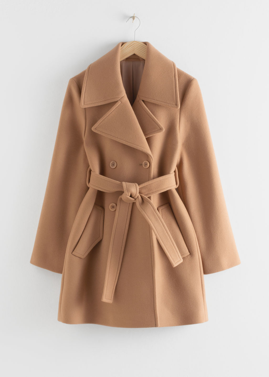 Front image of Stories double breasted belted coat in beige