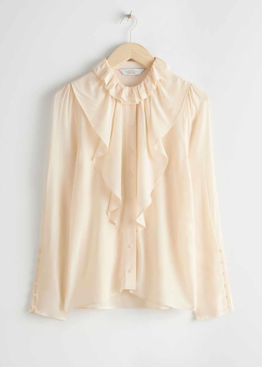 Front image of Stories ruffle bodice button up blouse in beige
