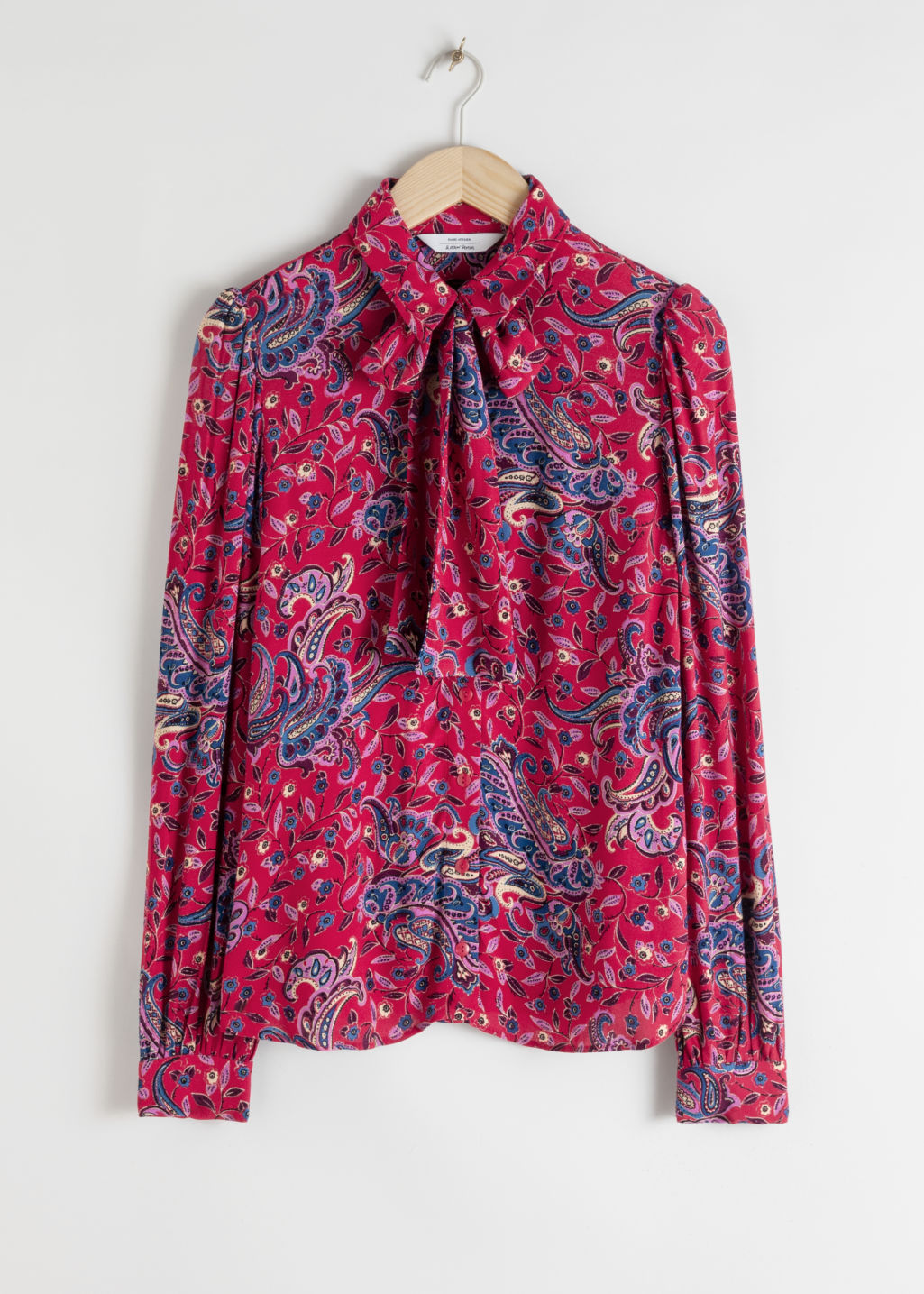 Front image of Stories pussy bow satin paisley blouse in pink