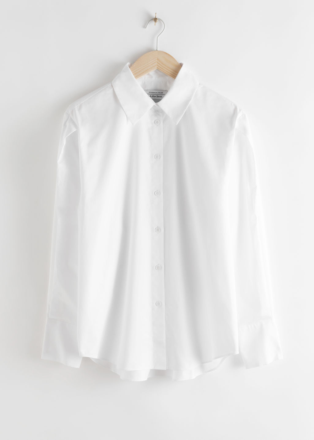 Front image of Stories pleated shoulder cotton shirt in white