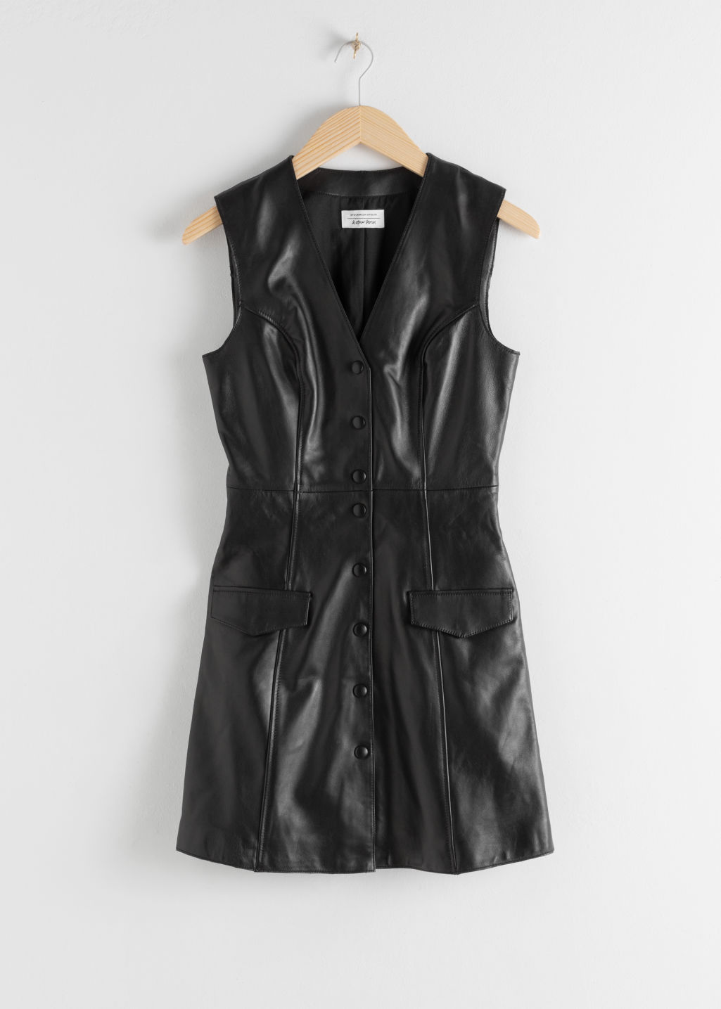 Front image of Stories leather sleeveless mini dress in black
