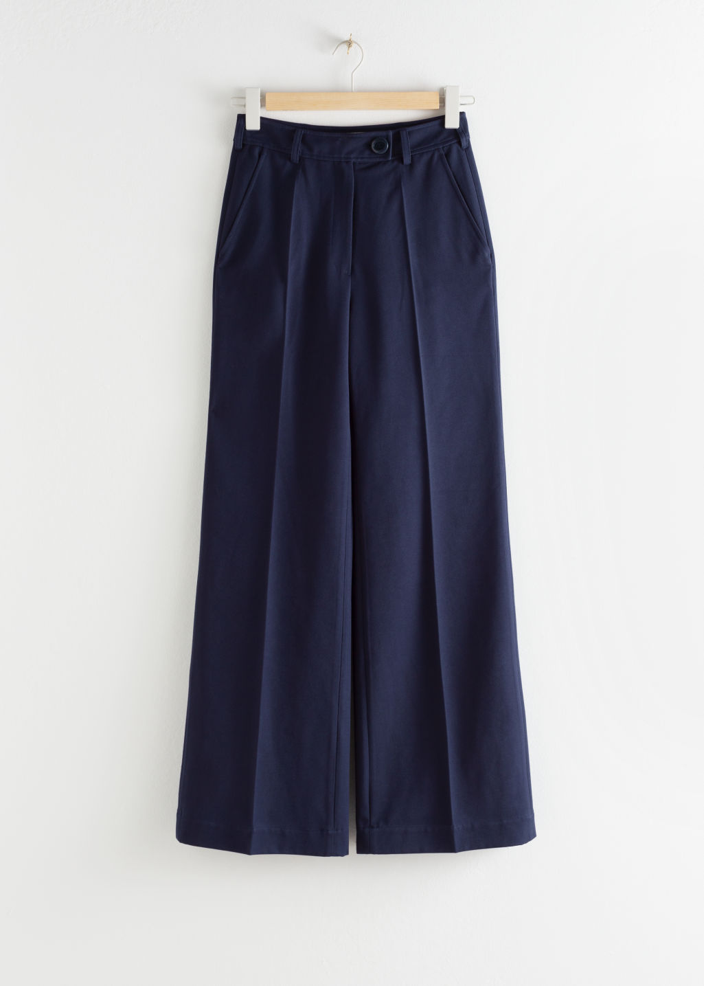 Front image of Stories tailored twill flare trousers in blue