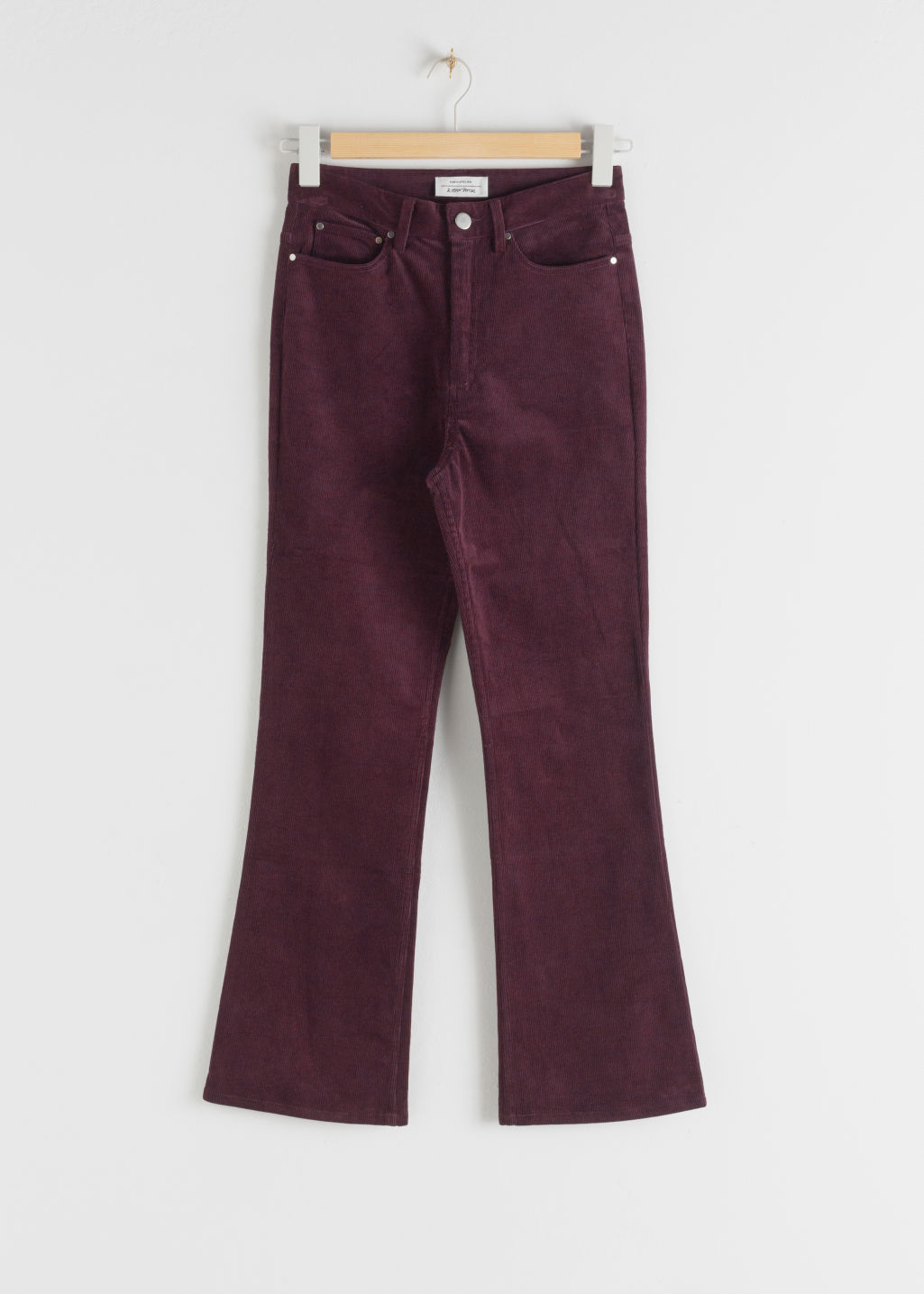 Front image of Stories corduroy kick flare trousers in red