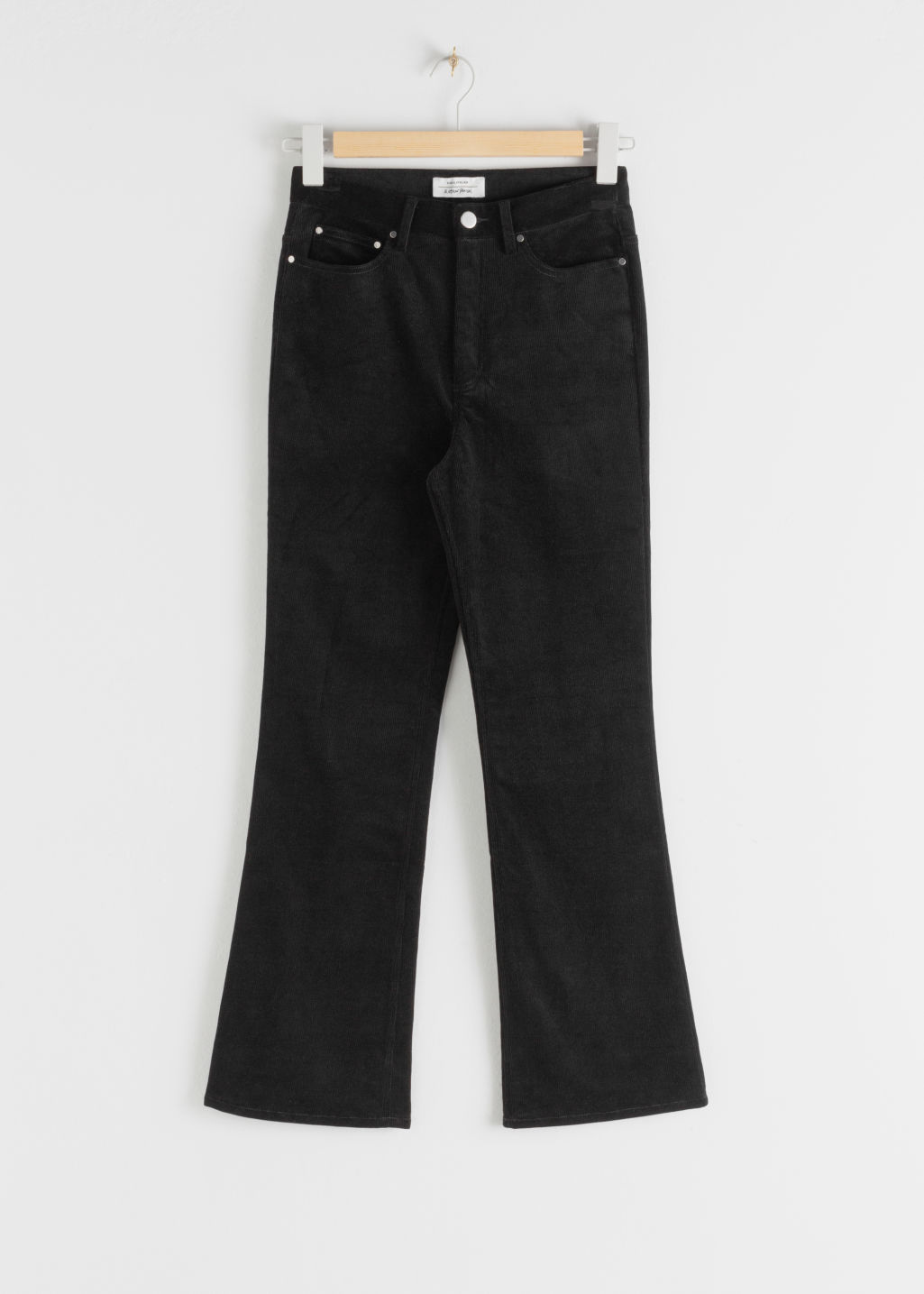 Front image of Stories corduroy kick flare trousers in black