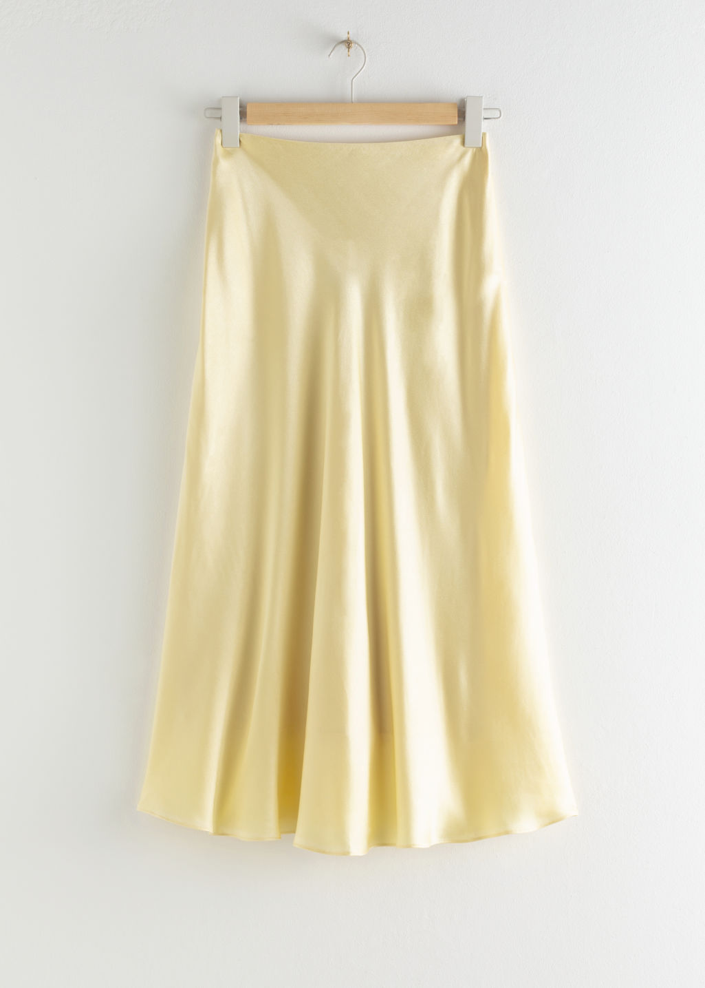 Front image of Stories bias cut satin midi skirt in yellow