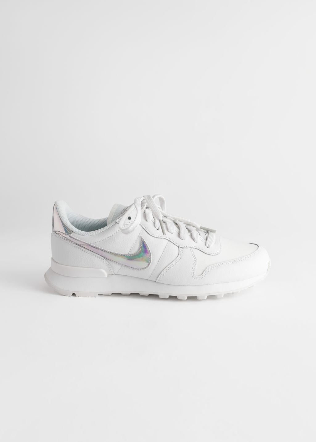 Front image of Stories nike internationalist in white