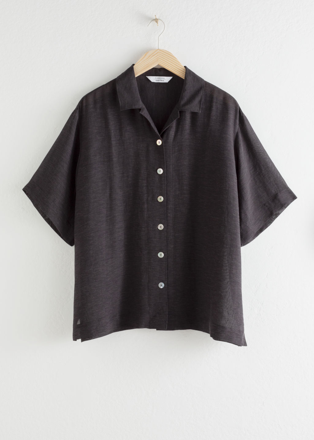 Front image of Stories lyocell blend button up shirt in black