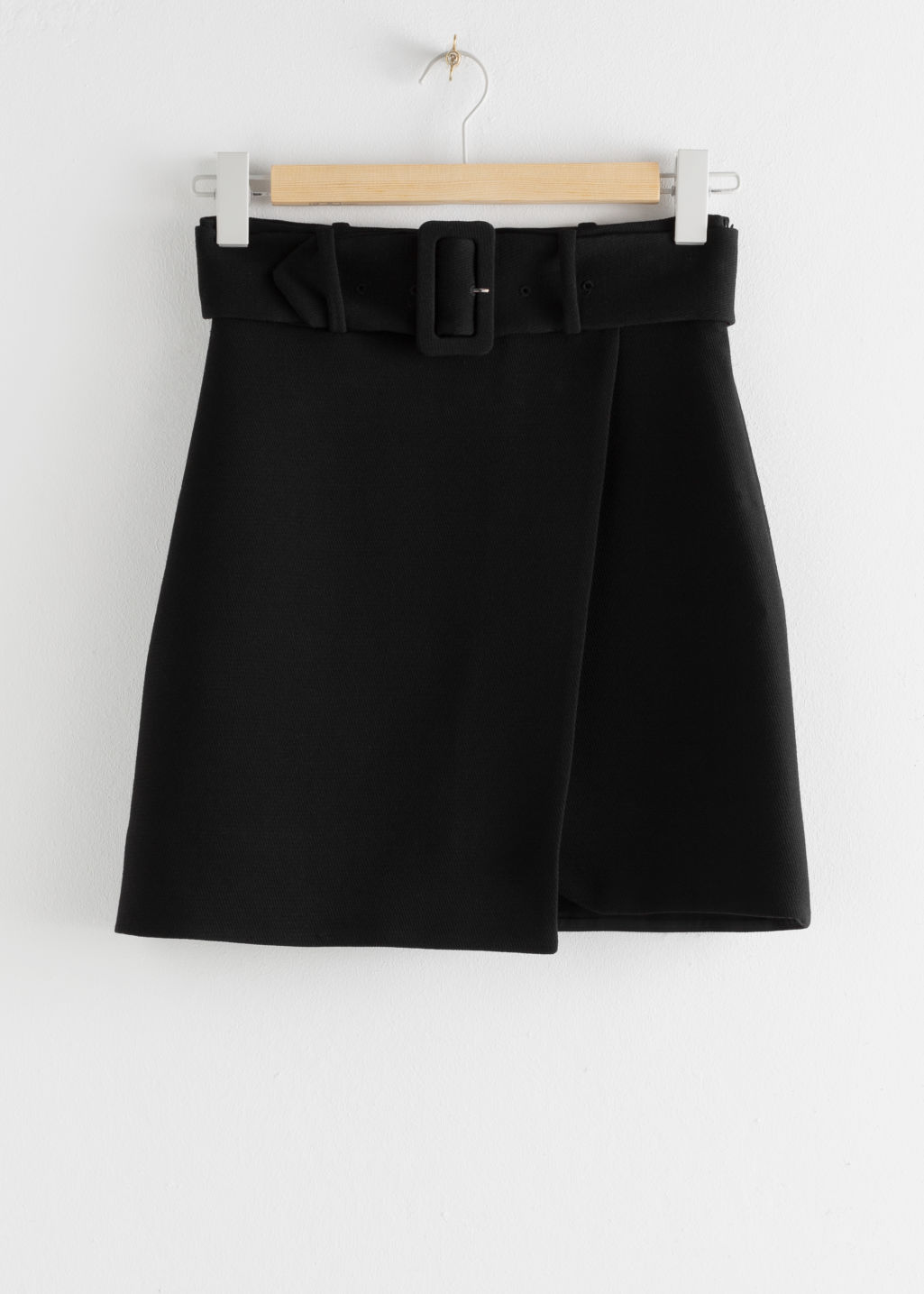 Front image of Stories belted overlap mini skirt in black