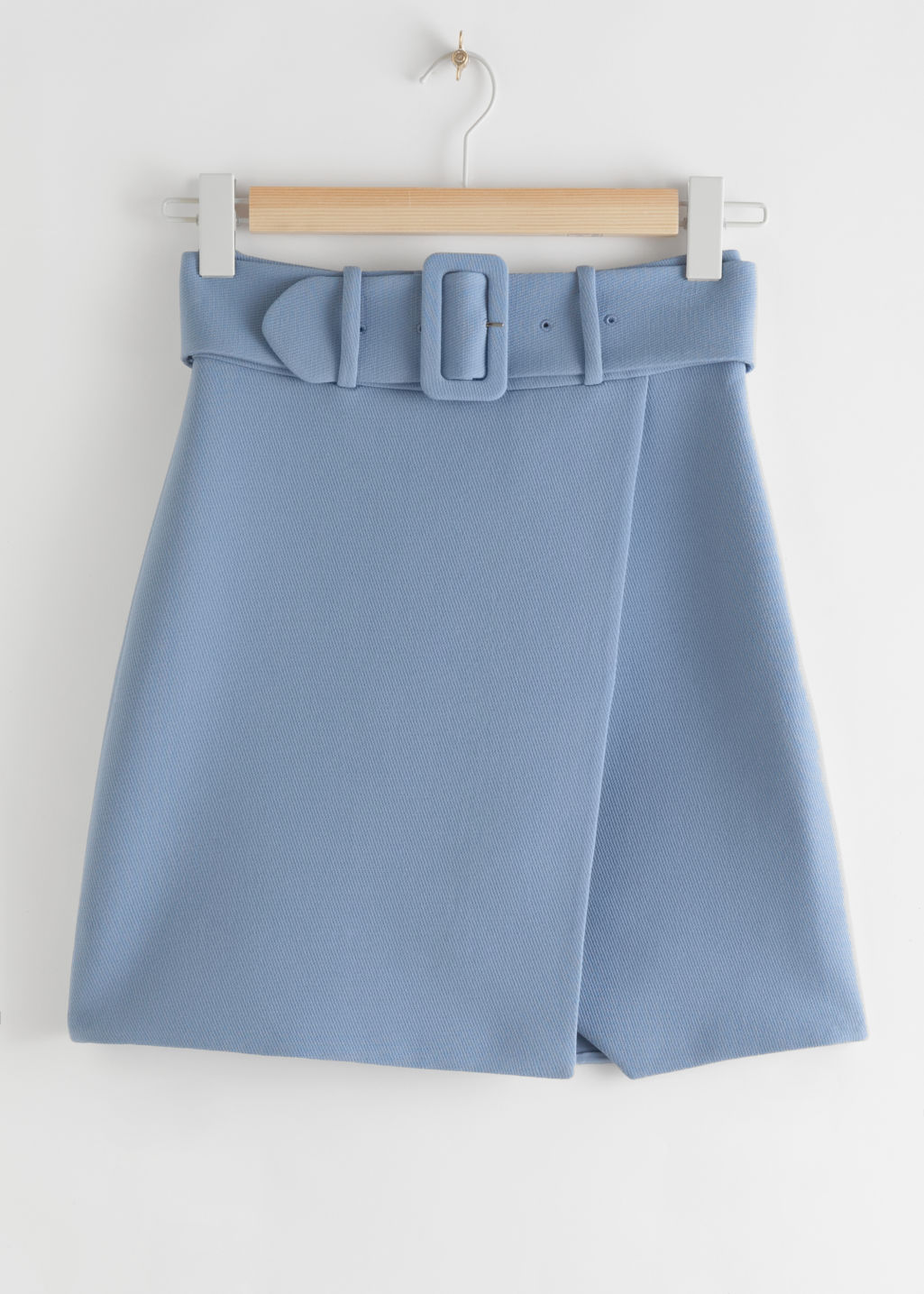 Front image of Stories belted overlap mini skirt in blue