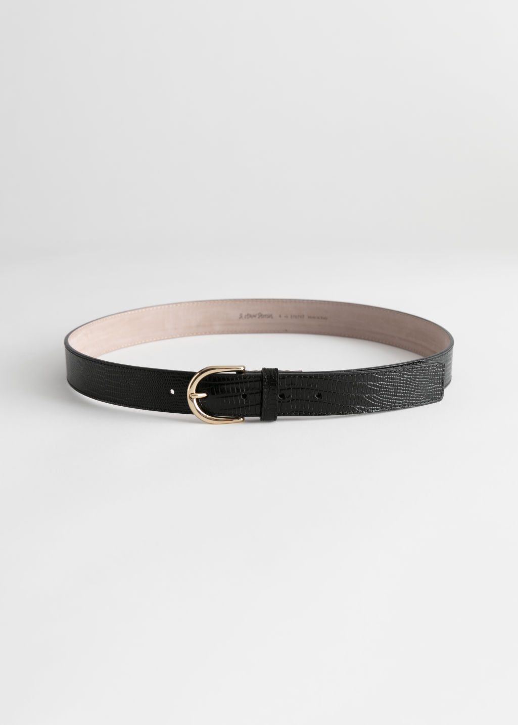 Front image of Stories snake embossed leather belt in black