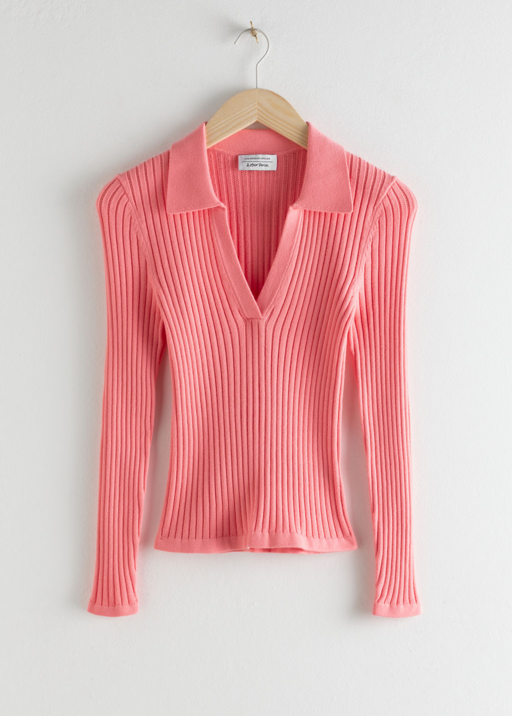 Front image of Stories ribbed v-neck polo knit top in pink