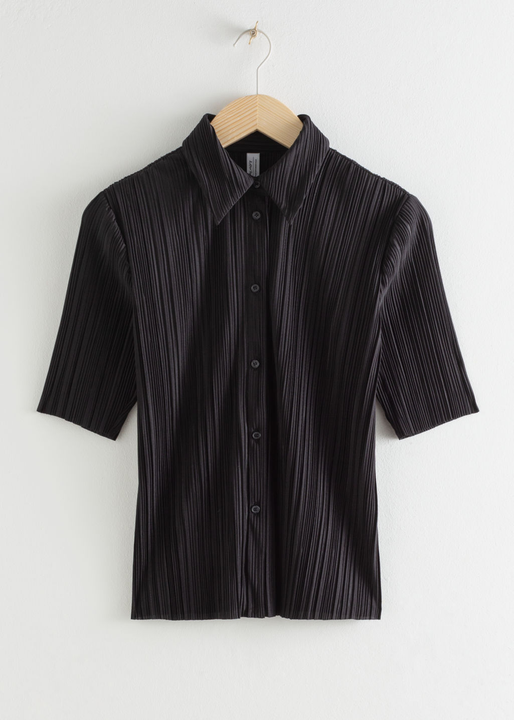 Front image of Stories plissé pleated button down blouse in black