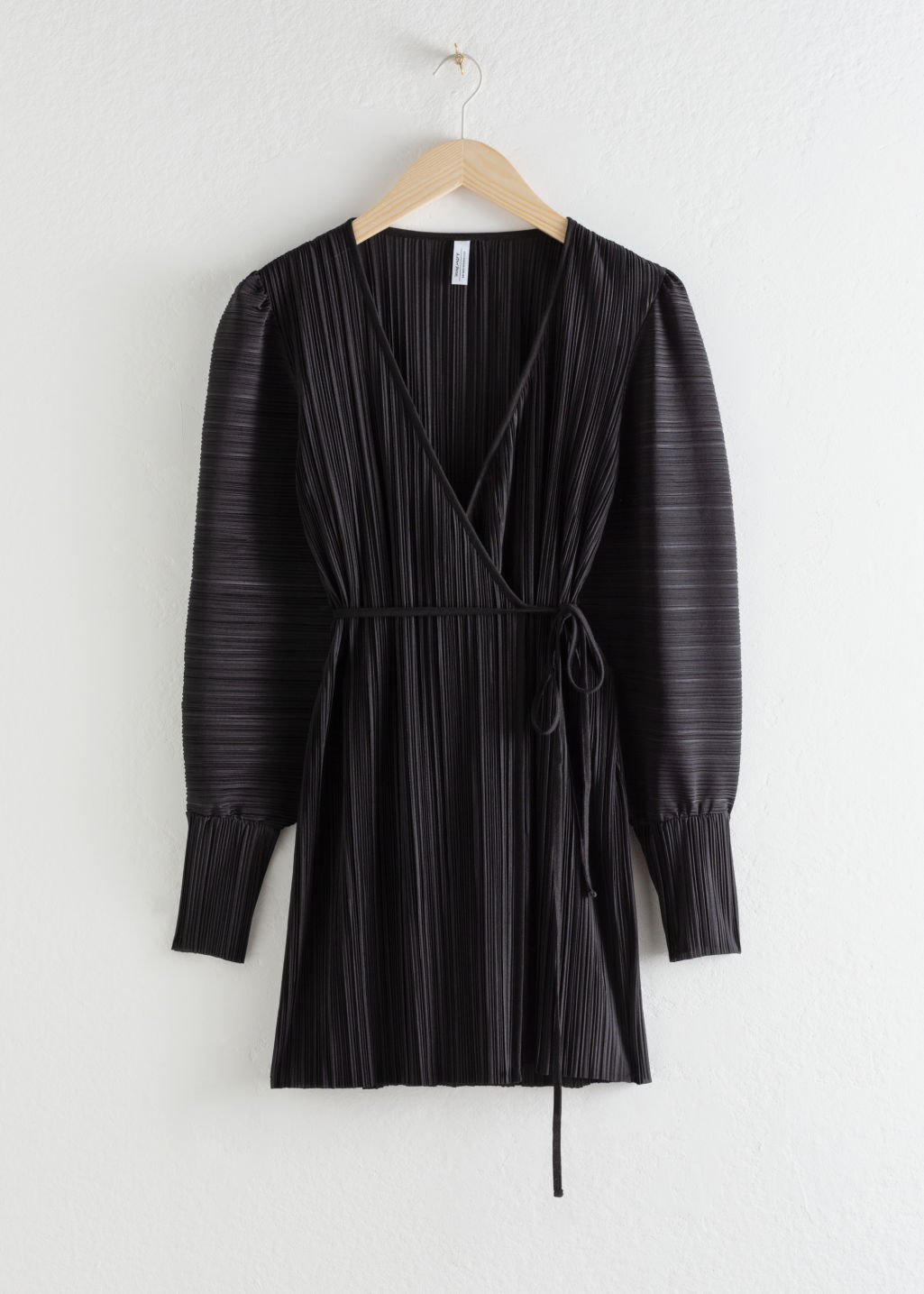 Front image of Stories plissé pleated mini wrap dress in black