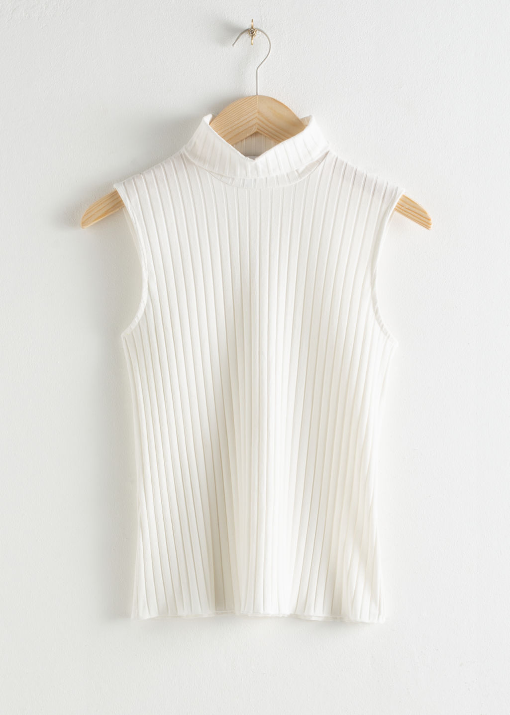 Front image of Stories ribbed turtleneck tank top in white