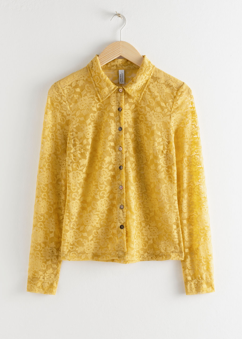 Front image of Stories sheer floral lace blouse in yellow