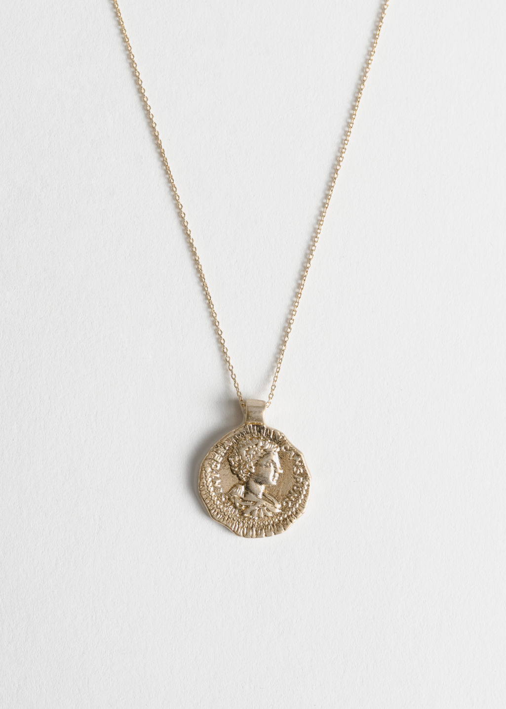 Front image of Stories face pendant necklace in gold